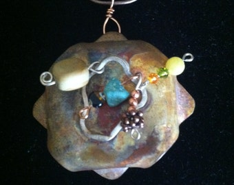 hand forged copper with ss accent and semi-precious beads, chain is 24 inches long. one of a kind.