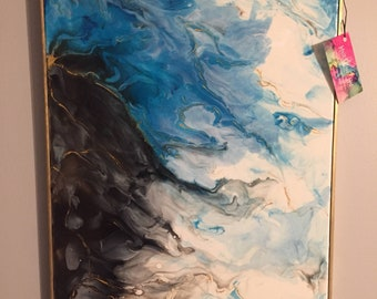 SOLD! Acrylic pour painting done with blues, black, white, and gold