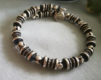 Vintage style Black and silver wire wrap-a-round bracelet, Lots of detail, very artsy.