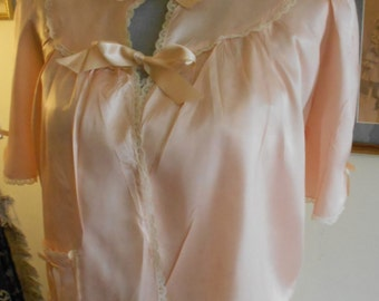 """1940's, 38"""" bust, rayon satin light coral colored bed jacket"""