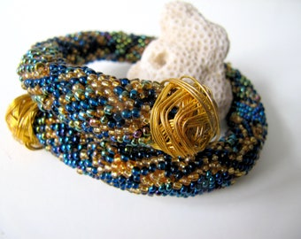 Bead Crochet Rope bracelet spring with gold hardware Python pattern Suitable for denim outfits on shoulder and on wrist.