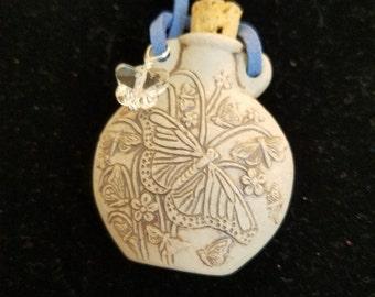 Butterfly raku potion bottle necklace