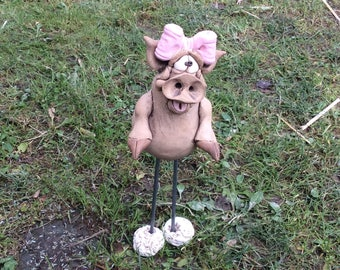 little girl piggy with a bow on legs with feet
