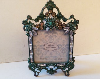 Pretty in blue..ornate frame with glass