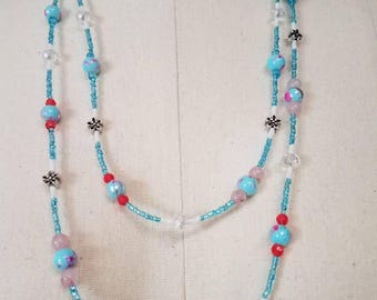 Pink and Blue Lariat necklace with sparkles and flowers.