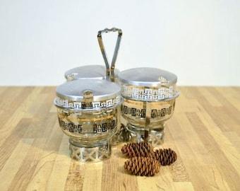 Mid Century Modern Condiment Carousel Server Glass and Aluminum Pine Cone Design Lids Black Gold White Pattern