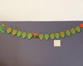 Dinosaur Happy Birthday Banner on leaves