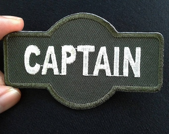 Retro captain embroidered iron on patch.