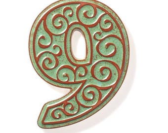 ceramic house number 6 , green-brown
