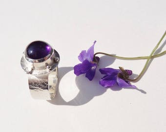Beautiful Amethyst cabochon mounted in sterling silver ring