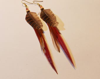 Red natural feather earrings