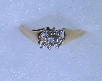 14K gold Devotion diamond ring with 9 diamonds