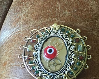 Steampunk watchful eye wire wrapped pendant