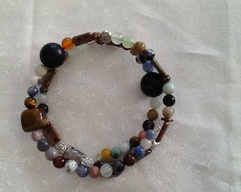 Memory wire bracelet with a variety of beads including tigereye nuggets.