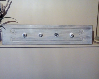 Coat rack, coat hook.