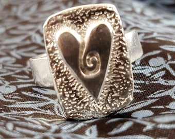 Size 7 Adjustable Swirling Heart Ring in sterling silver
