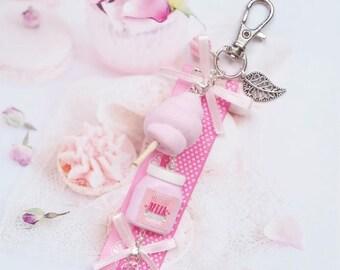 gioiello di borsa tratta rosa in fimo