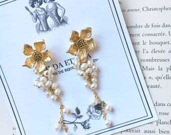 Earrings dangling gold tone flowers with freshwater pearls