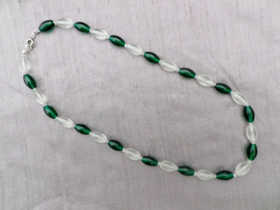Opaque green and white glass oval bead necklace, 19 inch chain