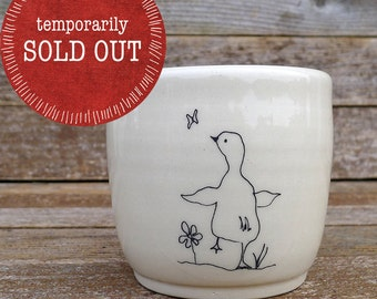 handmade ceramic cup: duck and butterfly