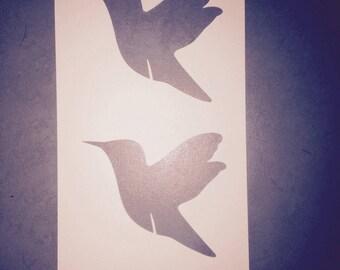 Stencils in the shape of colibri birds per sheet