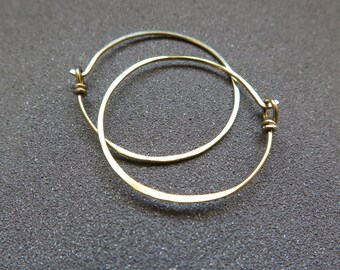hypoallergenic earrings. yellow gold hoops. small niobium hoops. anodized jewelry. made in Calgary, Alberta.