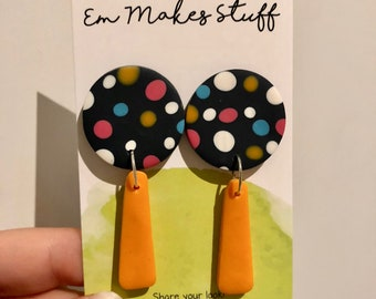 Dots and orange dangle earrings