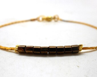 Gold minimalist bracelet, bronze faceted beads