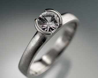 Round White Sapphire Half Bezel Solitaire Engagement Ring in Palladium, White, Rose & Yellow Gold, Platinum, Diamond Alternative