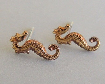 Tiny golden seahorse post earrings - minimalist stud earrings