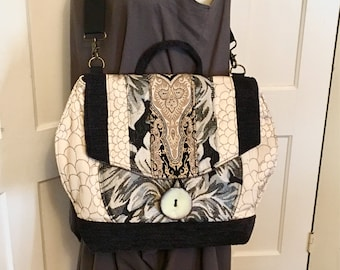Black and white messenger bag backpack