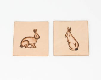 Leather coasters with hand-painted bunny rabbit motifs - set of two