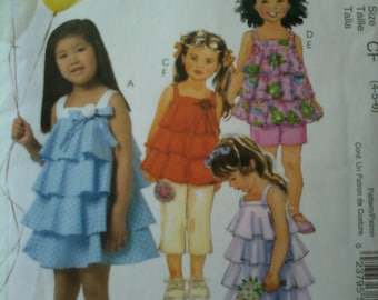 McCall's Sewing Pattern M5085 to make girl's dress, top, shorts and capri pants in sizes 4,5,6.