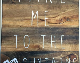 Take me to the mountains sign