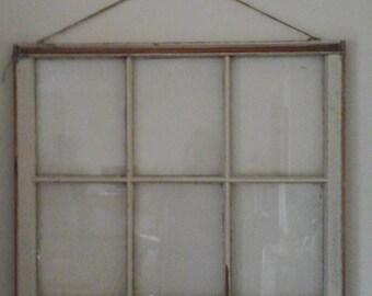 Vintage old 6 panel window with twine