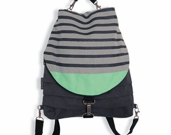 Carolin backpack and transformable fabric bag, convertible backpack in shoulder bag and handbag. Graphite and grey Color, stripes and green.