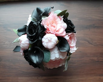 Modern pink and black brides bouquet, pink peonies and roses. Black roses and calla lilies. Eucalyptus and lamb ear wrapped in black satin.