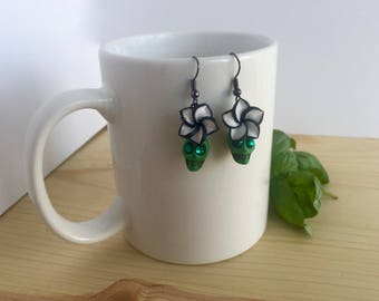 Gorgeous bright green sugar skulls with green rhinestone eyes and black and white flower accents silver earrings; Green skull earrings