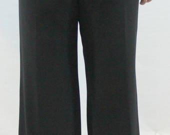 Black pair of trousers with side zipper and small waist band. unlined. Fall pants, black slacks, stretchy slacks. versatile slacks.