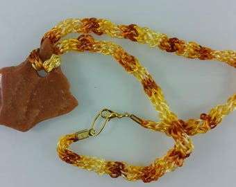 Necklace: Red Aventurine slab pendant with knitted cord in artificial silk; red-brown, yellow, orange