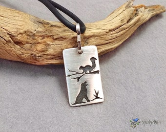 Dog and squirrel silhouette pendant in carved fine silver, sterling silver bail . Squirrel necklace . Dog silhouette necklace