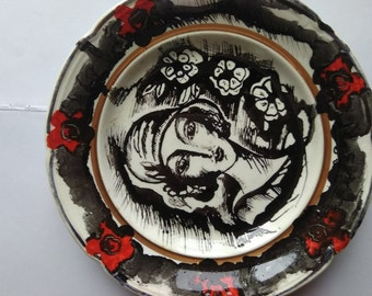 Hand-painted woman on a plate