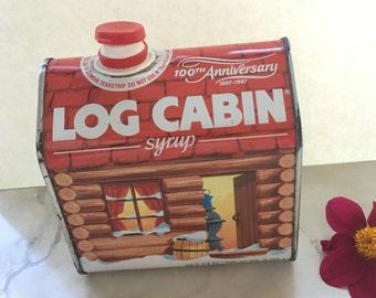 Vintage metal  Log Cabin tin