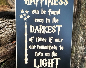 Harry Potter Happiness can be found even in the darkest of times if one only remembers to turn on the light Albus Dumbledore carved sign