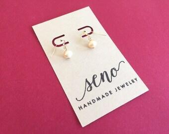 Freshwater pearls earrings, gold filled hooks, plastic hooks available.