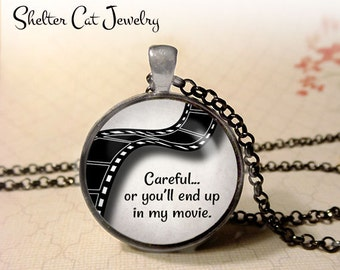 "Careful or You'll End Up In My Movie Necklace - 1-1/4"" Circle Pendant or Key Ring - Quote, Writer, Screenwriter, Filmmaker, Film Gift"
