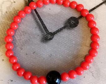 Stretchy beaded bracelet, Orange and black beads