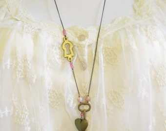 Antique Key Necklace with heart shaped locket and antique keyhole in pinks