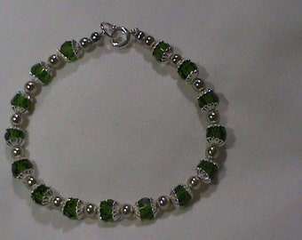 Emerald Green Crystal with bead cap and Light Green Pearl Bracelet