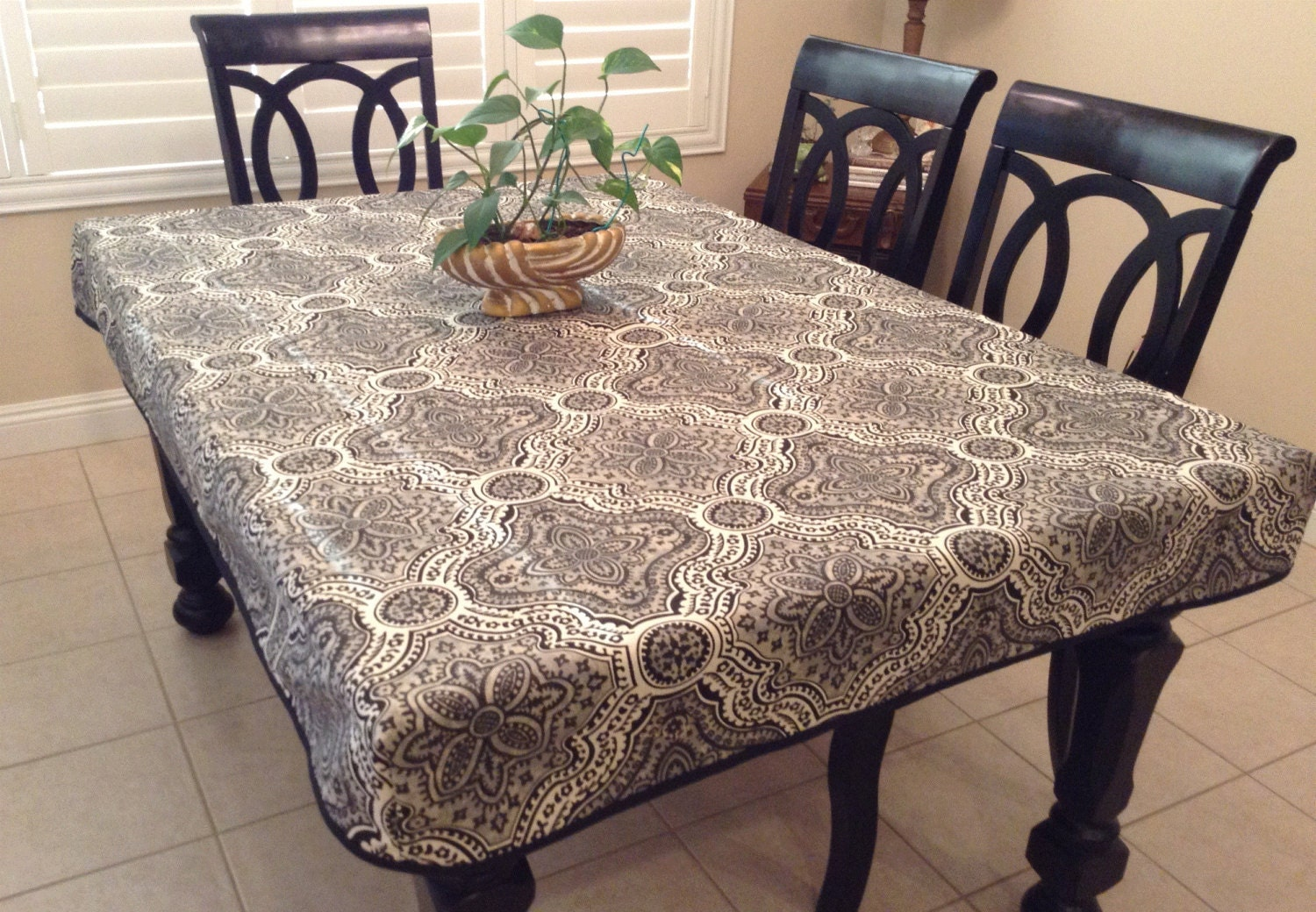 Rustic print fitted tablecloth with skirt and doublefold bias